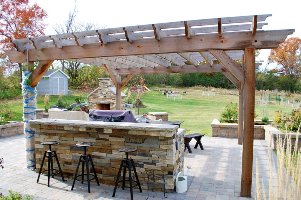 The beams, rafters, and battens on this pergola are all cut in a decorative curved design.