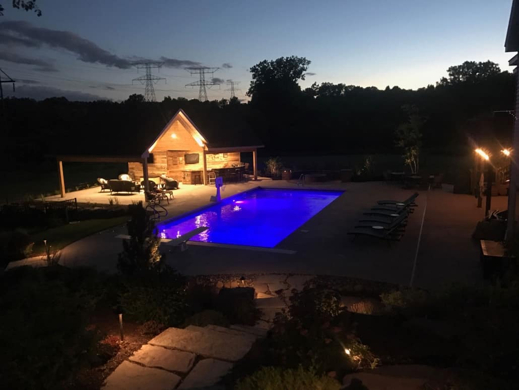 Lighting can highlight your choice in pool materials.