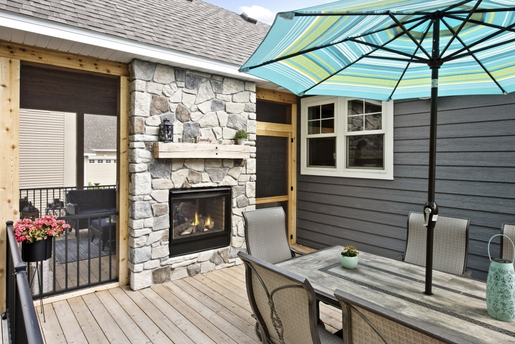 Gas Fireplaces are a great option between a porch and deck.