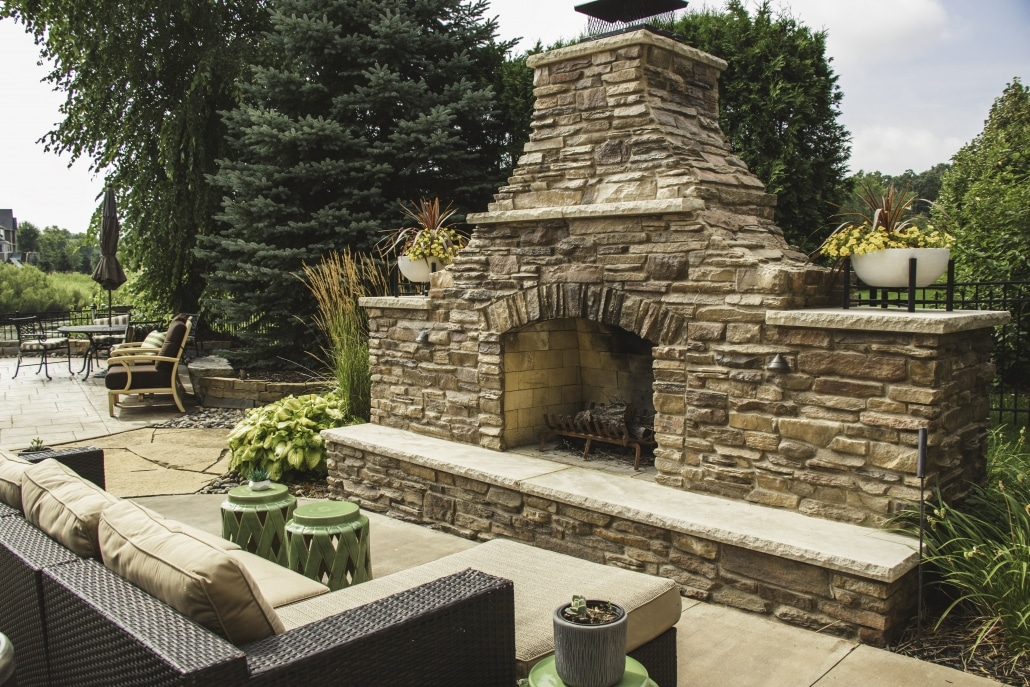 The custom masonry on this outdoor fireplace make it a one of a kind Landscapes Unlimited creation.