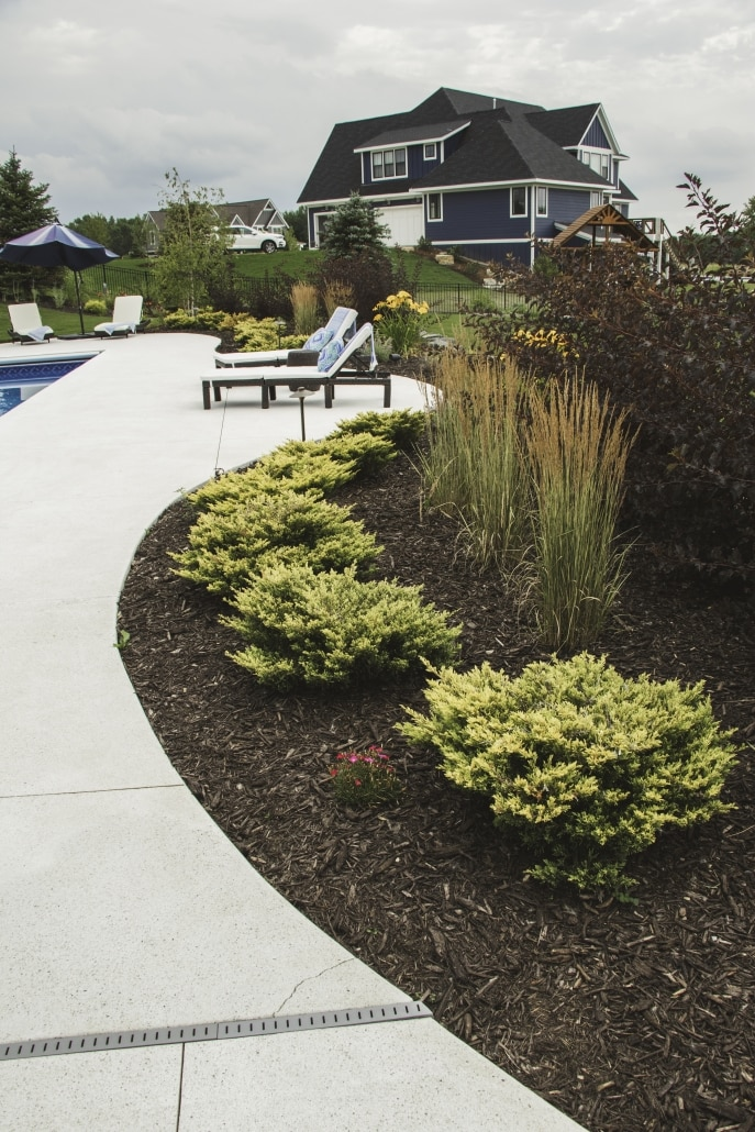 Mulching can provide contrast and texture against plantings and hardscapes.