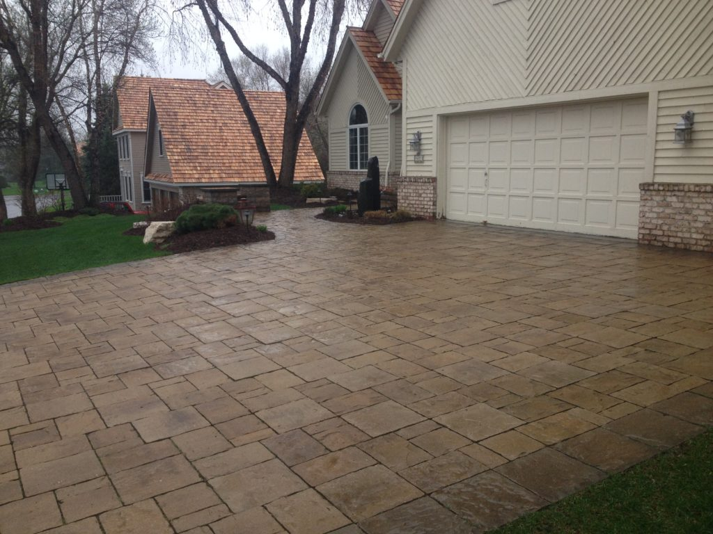This Paver Driveway gives this home a natural stone look without the labor.