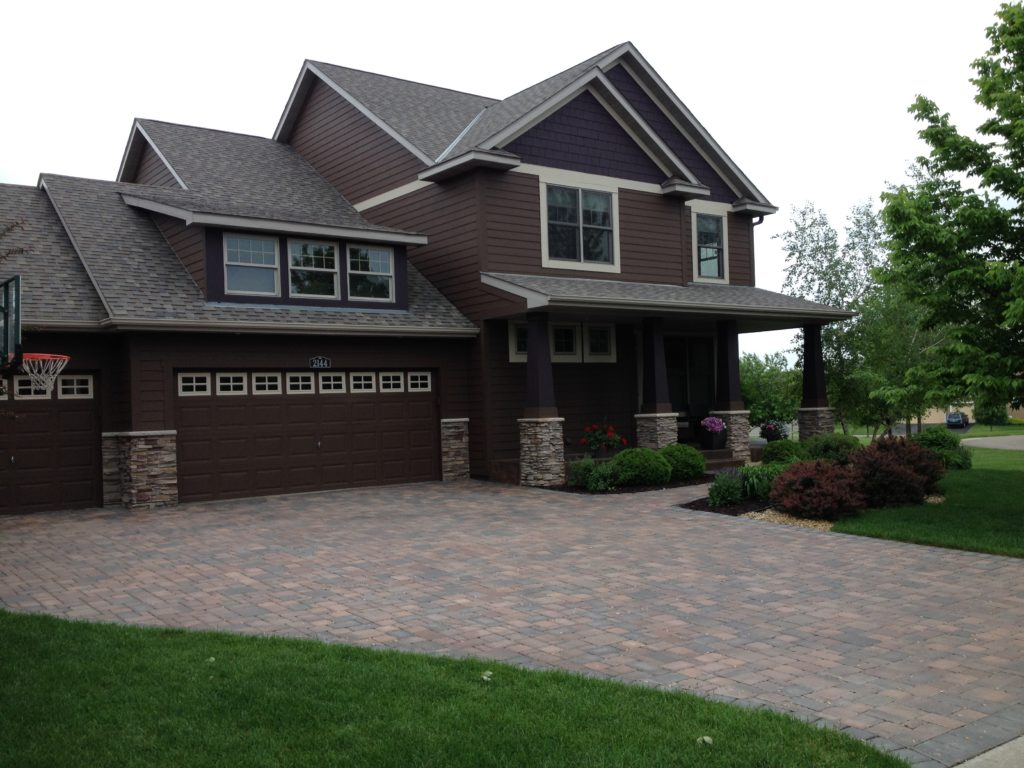 A Woodbury, MN Home is beautifully accented with this paver driveway.