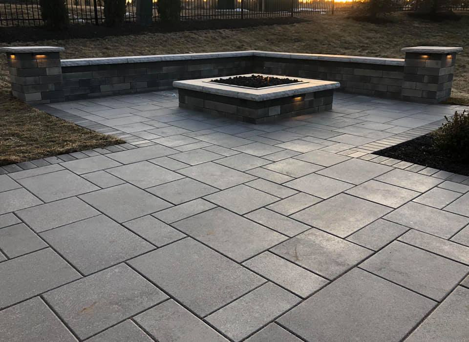 A beautiful random pattern with border on this paver patio.