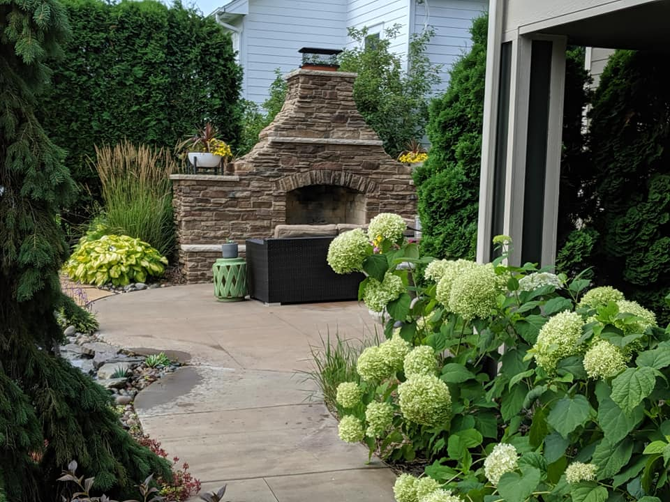 Soft, smooth, coarse, and bulky textures all come into play in this patio design.