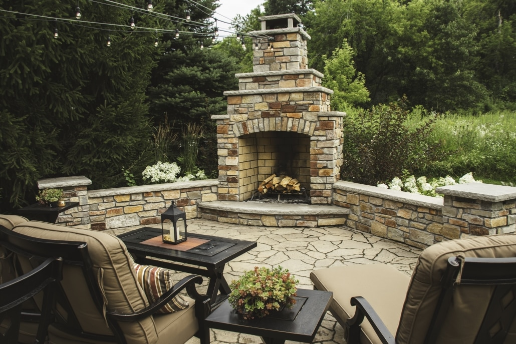 This outdoor fireplace is positioned so that these homeowners and their guests can take in the beautiful background while maintaining their privacy.