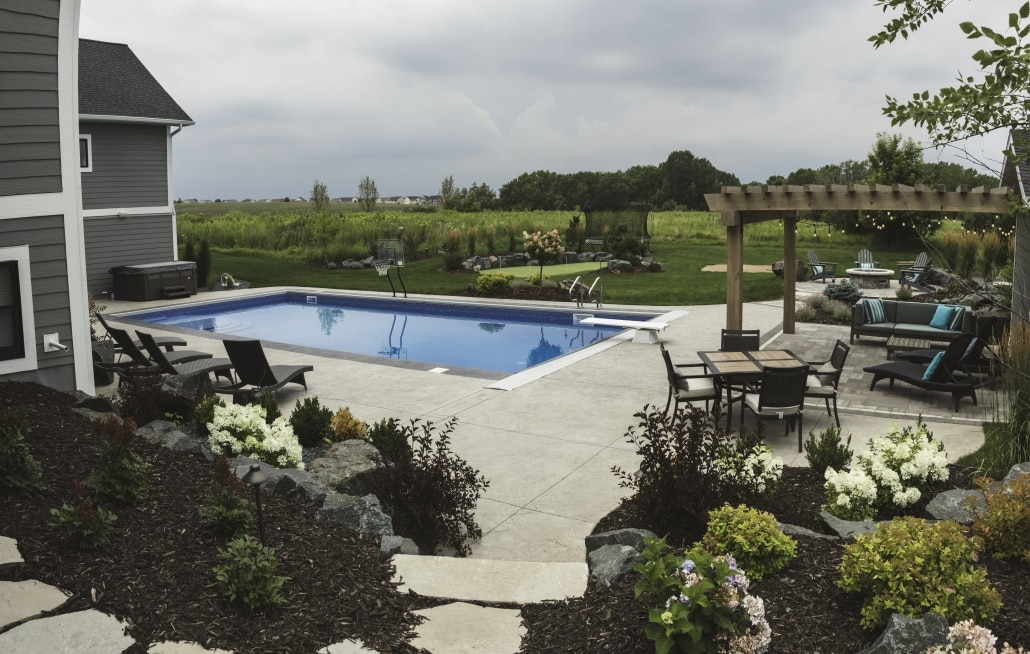 Create a calm centerpiece for your backyard with a pool.